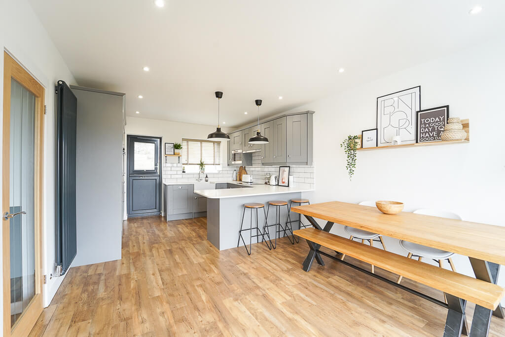 The modern, open-plan, kitchen/dining area has bi-fold doors with views over the estuary from this stylish five-six bedroom house