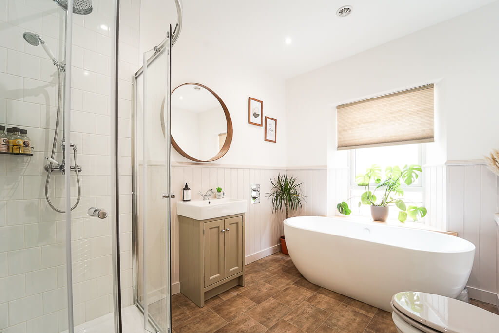 One of two family bathroom areas in this five-six bedroom house, this one has an elegant modern suite